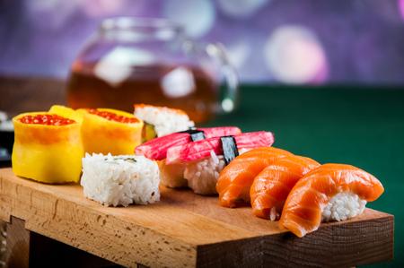 Fresh and tasty oriental sushi, Japanese theme