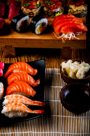 Sushi set on the wooden table photo