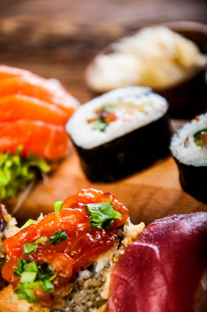 Decorative composition with sushi, Japanese seafood photo