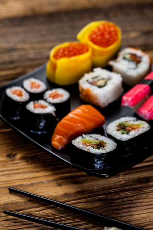 Seafood, Japanese sushi on the old wooden table photo