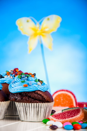 Home baked sweets on the bright, blue background photo