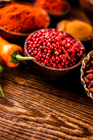 variability: Colorful spices in wooden bowls