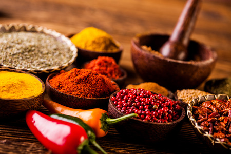 variability: Spices in traditional Asian theme on wooden table Stock Photo