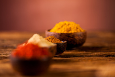 variability: Plenty of traditional Asian spices in wooden bowls