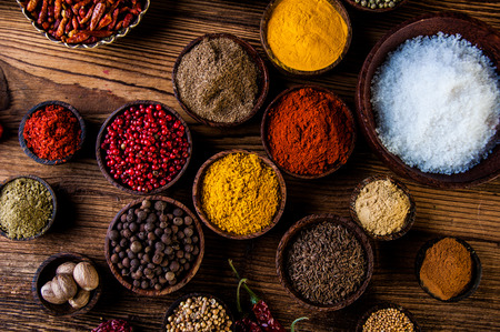 red indian: Oriental hot spices on wooden table Stock Photo