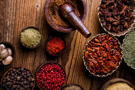 variability: Oriental hot spices on wooden table Stock Photo