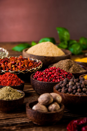variability: Variability of Asian spices on wooden table