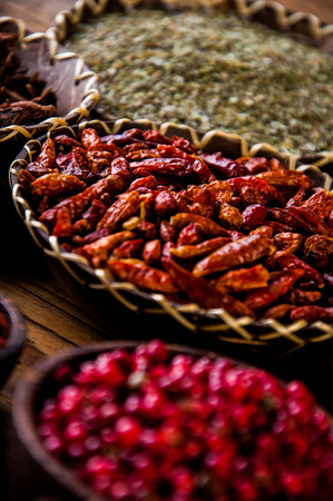 variability: Wooden table of traditional Asian spices