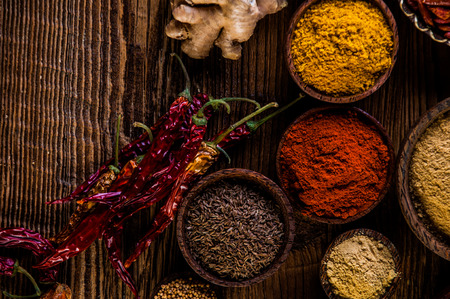variability: Colorful theme with spices on wooden table Stock Photo
