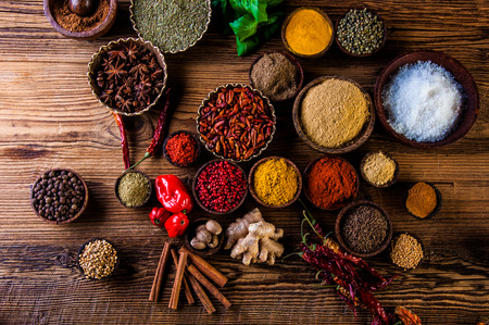 Colorful theme with spices on wooden table Stockfoto