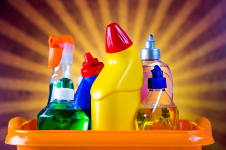 Cleaning concept with bottles and brushes Stock Photo