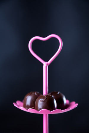 Delicious valentines sweets on dark background