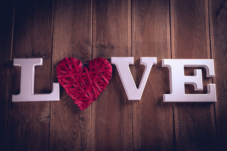 Valentine concept on wooden table with white letters