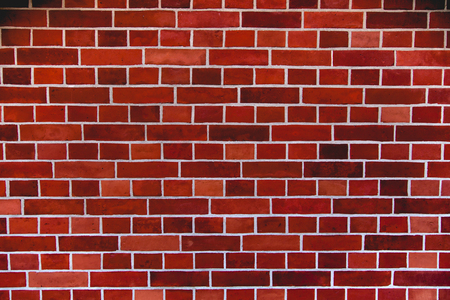 Red brick wall artistic background, regular texture