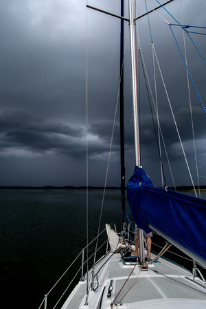 transom: Sailing concept with boat and lake water storm weather