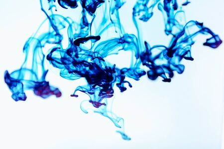 Blue ink in water, artistic shot, abstract background
