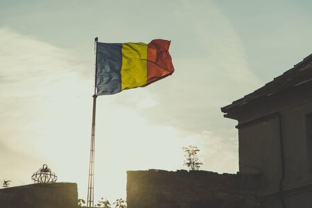 light duty: Romanian flag is waving with sunset in background
