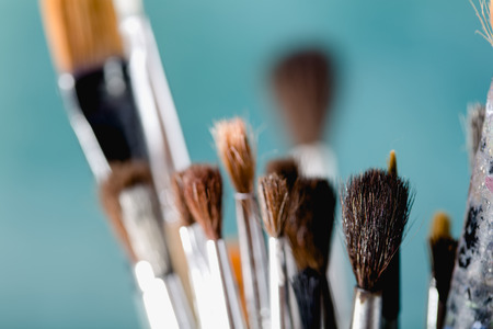 Variety of different brushes on blue background