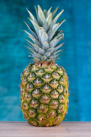 Fresh pineapple on blue background Zdjęcie Seryjne