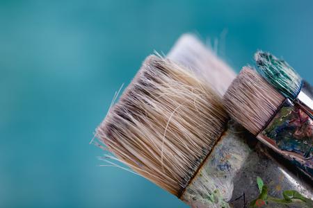 Paint brushes on light blue background, close up shot Zdjęcie Seryjne