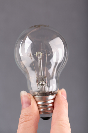 Electric bulb in hands, close up shot