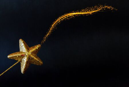 Golden star magiс wand isolated on black background
