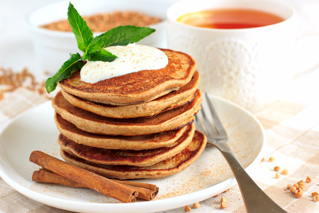 Sugar free buckwheat pancakes with banana Фото со стока