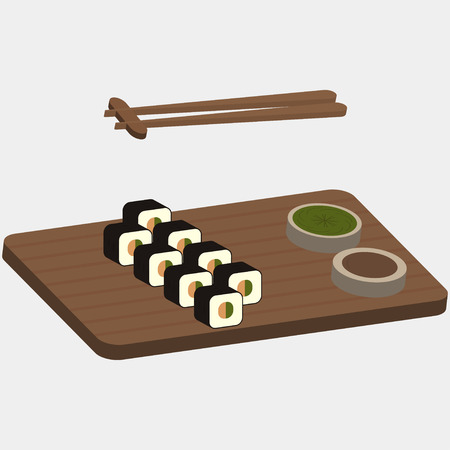 Sushi and rolls on the wooden boards