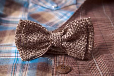 Blue bow tie on textile suit background