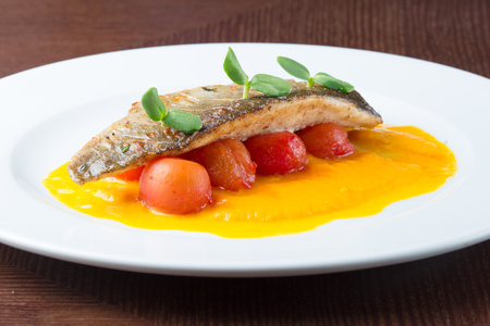 Grilled fish on tomatoes