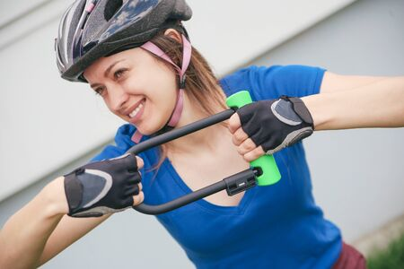 Girl with bicycle lock