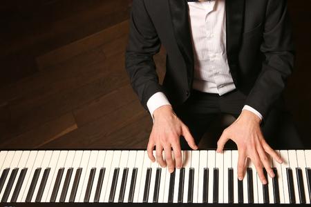 Pianist playing piano. Reklamní fotografie