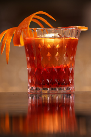 alocohol cocktail negroni on black surface