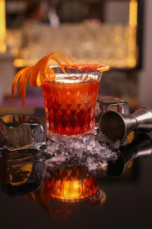 alocohol cocktail negroni on black surface