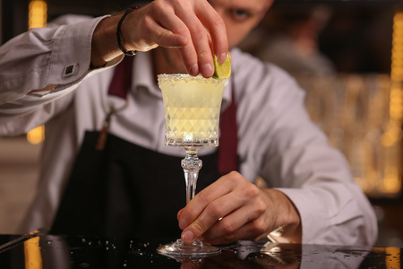 Margarita alcohol cocktail with lime ice barmen Stock Photo