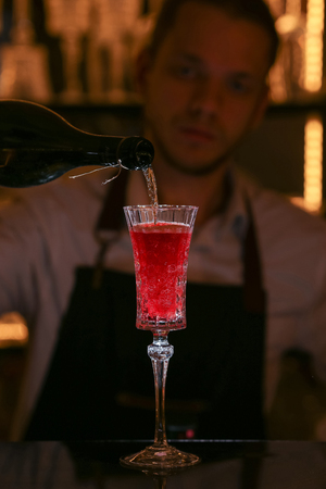 Kir Royal cocktail with orange slice and ice cubes. Stock fotó