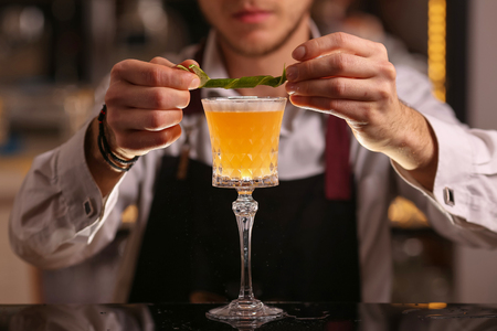 Bartender is making Pisco sour alcohol cocktail drink