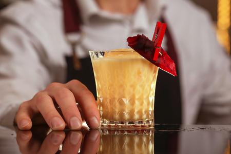 Batida cocktail drink with mint making by bartender