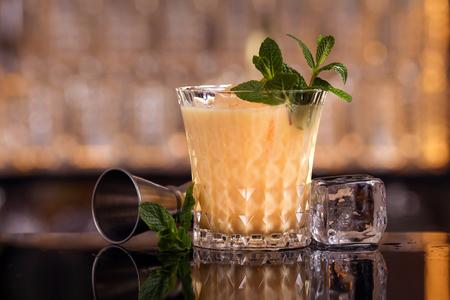 Batida cocktail drink with mint making by bartender Foto de archivo