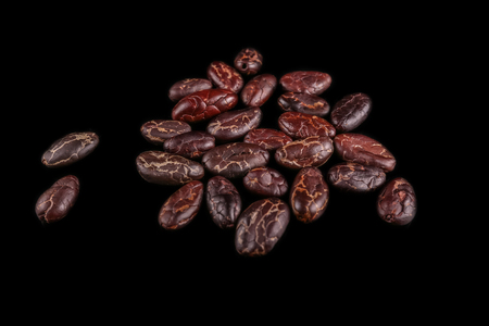 Roasted beans. Cocoa beans and coffee beans isolated on black background. Stock fotó
