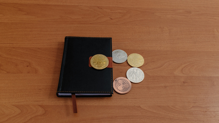 The background e-money lies on a notebook. bitcoin other coins. Фото со стока