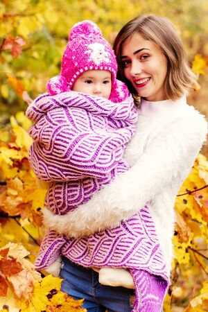 Mother with baby in autumn park