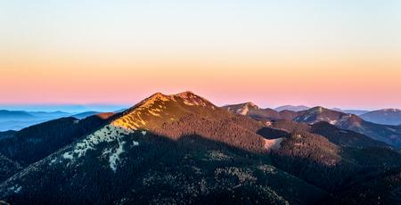 Morning landscape. Sun is shining on a rocky mountain top.  Autumn in the Ukrainian Carpathians