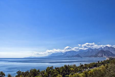 Panoramic view on Antalya beach, mountains and Mediterranean Sea from the Beach park. Antalya, Turkey.