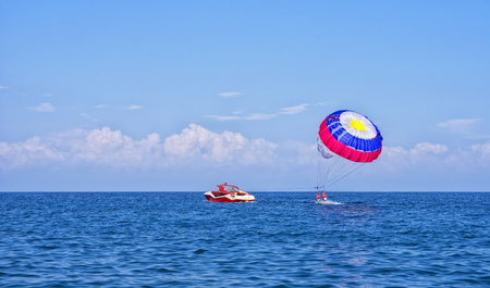 Parasiliors take off. The active and extreme form of relaxation. Kemer, Turkey. Stock Photo