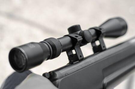 Optical sight of a sniper rifle close-up. Black optical sight