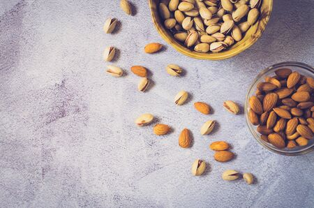 Almonds and pistachios on a light background. View from above