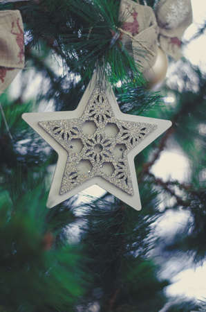 Beautiful Christmas tree decorations hang on the tree, close-up.