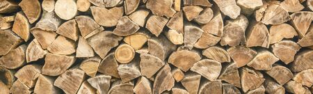 panorama. pattern of firewood. light wooden background