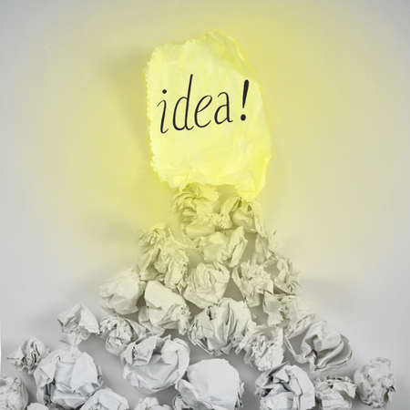 new ideas concept. sheet of paper, paper balls, colorful pencils on white background